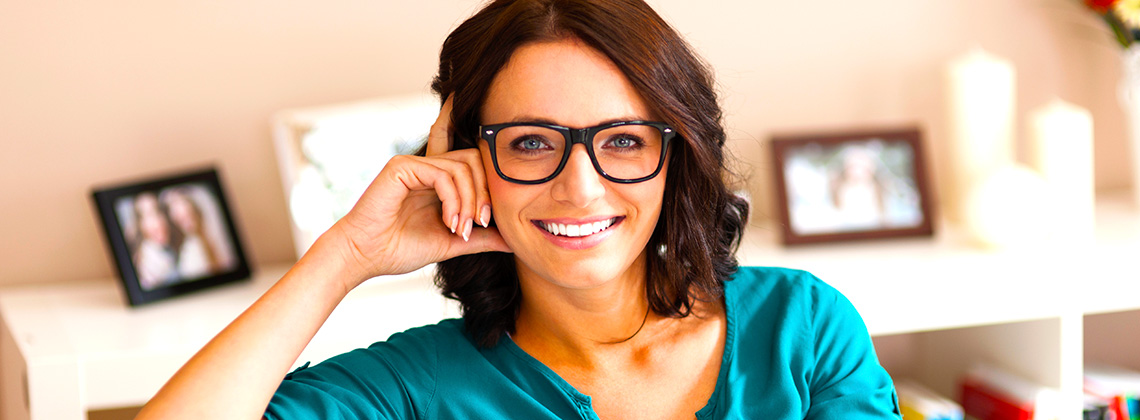 Brunette Woman Wearing Thick-Rimmed Glasses